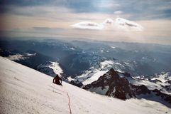 Mountian Climb. Resting while leading the decent of Mount Rainier at 14,000 ft after a successful summit Stock Photography
