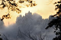 Mountian sunrise. Scene of sunrise in the misty famous Huangshan China in winter Stock Photos