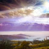 Mountians village under fog Royalty Free Stock Image