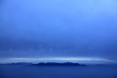 The mountin in sky. Qilian mountin in the clouds Stock Photography