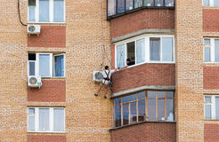 Mounting the air conditioner on the wall of an apartment house Royalty Free Stock Images