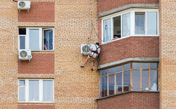 Mounting the air conditioner on the wall of an apartment house Royalty Free Stock Image