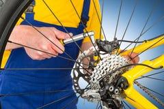 Mounting brake caliper on mountain bike Stock Photography