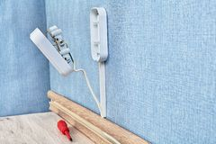 Mounting of duplex receptacle outlet. Electric plug house wiring during mounting with red screwdriver space closeup copy home wall power energy electricity wire stock photography