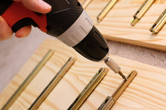 Mounting furniture with screwdriver Stock Images