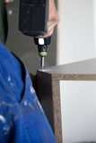 Mounting furniture with screwdriver Stock Photo