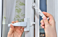 Mounting opening restrictor for PVC window, close-up. Stock Photos