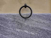 Mounting ring retainer on a wall with plastering and granite Royalty Free Stock Photography