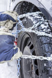 Mounting snow chains Stock Photography