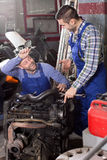 Mounting specialists in coveralls working Royalty Free Stock Image