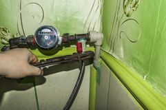 Mounting water meter for plumber. Work with the key. stock photo