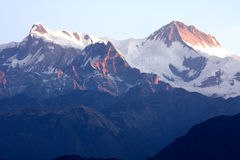 Mounts Annapurna II and IV at Dawn, Nepal. Image of Mounts Annapurna II and IV on the Dhaulagiri-Annapurna-Manaslu Himalayan Mountain Range, Nepal, taken at dawn Stock Photo