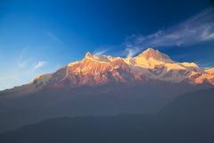 Mounts Annapurna II and IV at Dusk, Nepal. Image of Mounts Annapurna II and IV on the Dhaulagiri-Annapurna-Manaslu Himalayan Mountain Range, Nepal, taken at dusk stock photo