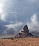 Monument Valley in the Storm. Storm clouds fill the sky around a solitary mountain pinnacle in the desert of Monument Valley in Arizona Royalty Free Stock Photo