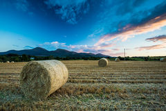 Mourne Mountains and County Down sunset. A sunset over a field with baled hay in County Down in Northern Ireland with the Mountains of Mourne in the distance royalty free stock images