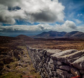 Mourne wall. The Mourne Wall near the reservoir in the Mourne Mountains, Northern Ireland Royalty Free Stock Images