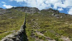 The mourne wall slieve binnian ireland Stock Photography