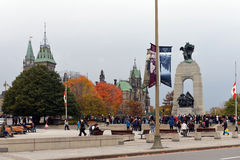Mourners gather and leave flowers at the Cenotaph in Ottawa Royalty Free Stock Photo