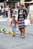 Mourners Gather for Mandela. People gather and lay flowers in Nelson Mandela Square in Sandton city, to pay respects to the former leader of South Africa Royalty Free Stock Image