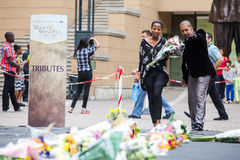 Mourners Gather for Mandela. People gather and lay flowers in Nelson Mandela Square in Sandton city, to pay respects to the former leader of South Africa stock image