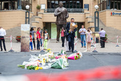 Mourners Gather for Mandela. People gather and lay flowers in Nelson Mandela Square in Sandton city, to pay respects to the former leader of South Africa royalty free stock photos