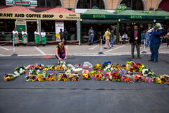 Mourners Gather for Mandela. People gather and lay flowers in Nelson Mandela Square in Sandton city, to pay respects to the former leader of South Africa Royalty Free Stock Images