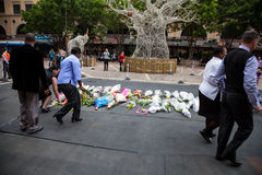 Mourners Gather for Mandela. People gather and lay flowers in Nelson Mandela Square in Sandton city, to pay respects to the former leader of South Africa stock images