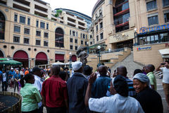 Mourners Gather for Mandela. People gather and sing songs in Nelson Mandela Square in Sandton city, to pay respects to the former leader of South Africa royalty free stock photography
