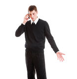 Mournful businessman talking on the phone Royalty Free Stock Photography
