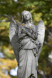 Mournful statue of chained angel Royalty Free Stock Photo