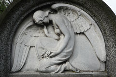 Mourning angel at the abandoned cemetery. Royalty Free Stock Image