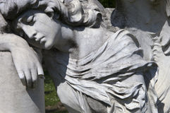 Mourning angel. Detail of mourning angel sculpture royalty free stock photo