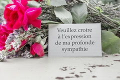 Mourning card. French Mourning card with roses and the text: My sincere condolences Stock Image