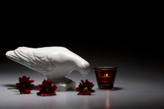 Mourning dove. A ceramic mourning dove with a candle and flowers Stock Photography