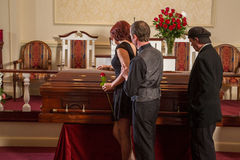 Mourning. Family and friends mourning at a funeral service Stock Image