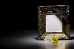 Mourning frame with flowers. Golden mourning frame with flowers on dark background Stock Images