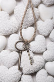 Mourning or hope concept - keys on a white background of stone h Royalty Free Stock Photography