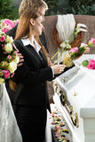 Mourning People at Funeral with coffin stock image