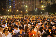 Mournment of the death in Tiananmen Square in 1989. HONG KONG - JUN 4, Tens of thousands of people packed Victoria Park with candles to mourn those who died in Stock Images
