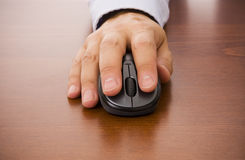 Mouse. Close-up of a male hand clicking on a wireless mouse Stock Images
