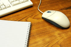 Mouse. And notebook on the desk Stock Photo