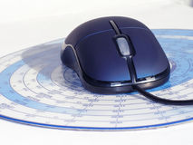 Mouse. Blue computer mouse and mouse-pad Royalty Free Stock Image