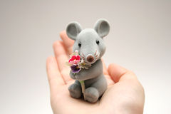 Mouse. On a hand royalty free stock image