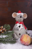 Mouse with Apple fir branch and snow for Christmas time. One mouse alone with sugar r- apple, fir branch before a dark colored wooden background royalty free stock photos