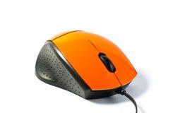 Mouse arancio sulla tabella bianca Fotografia Stock