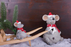 Mouse and baby mouse on a wheelbarrow with fir trees Royalty Free Stock Images