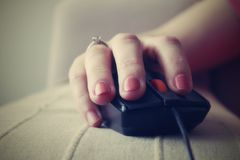 Mouse browsing. Browsing with mouse, red nails Royalty Free Stock Photo