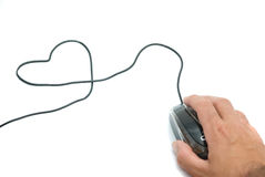 Mouse with cable folded to a heart-like figure Stock Photography