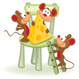 Mouse with cheese on a chair Stock Image