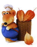 Mouse Chef with Physalis. Photo of the statuette Mouse Chef with wicker basket & Physalis on a white background royalty free stock photos